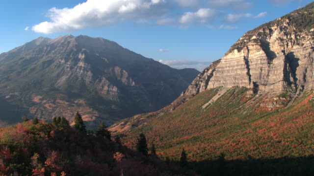flying past colorful trees viewing mountain valley - provo stock-videos und b-roll-filmmaterial