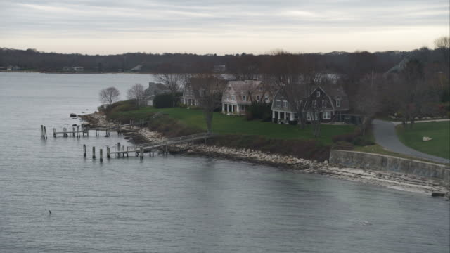 flying past homes along the shore of fishers island, new york. shot in november 2011. - artbeats stock videos & royalty-free footage