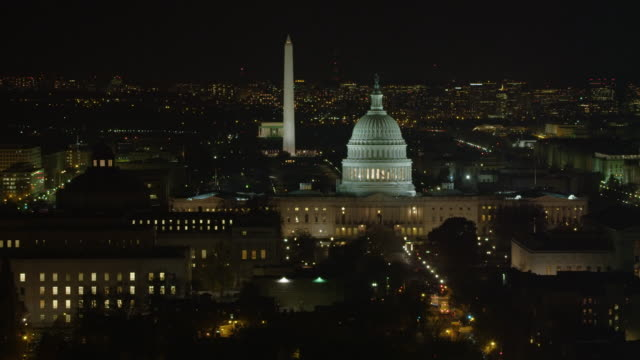 flying past library of congress at night; capitol building, washington monument, and lincoln memorial in rear. shot in 2011. - washington monument washington dc stock videos & royalty-free footage