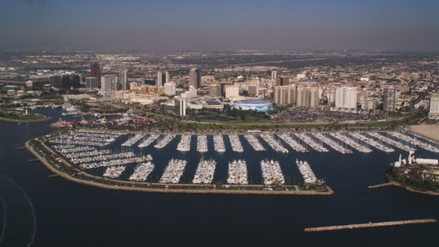 flying past long beach, california. shot in 2010. - artbeats stock videos & royalty-free footage
