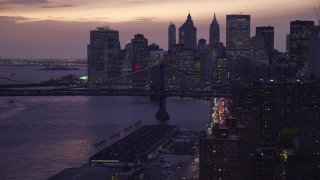 Flying past Manhattan Bridge at dusk,  skyline of Financial District in background. Shot in 2011.