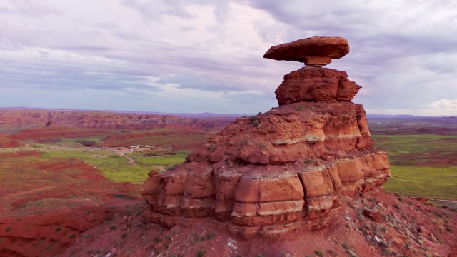 MS AERIAL Flying past Mexican Hat rock formation