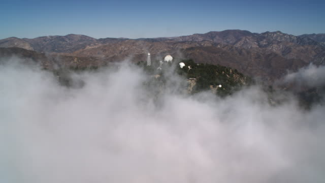 flying past mount wilson observatory in the rugged san gabriel mountains of california. shot in 2010. - artbeats stock videos & royalty-free footage