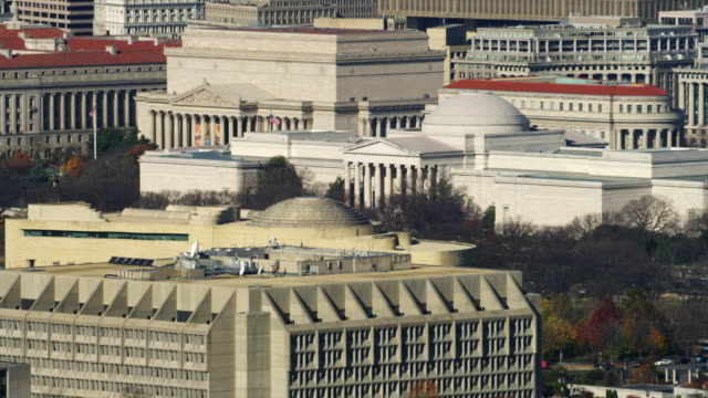 flying past national gallery of art toward old post office in washington dc; department of justice building in center frame at end of clip. shot in 2011. - department of justice stock videos & royalty-free footage