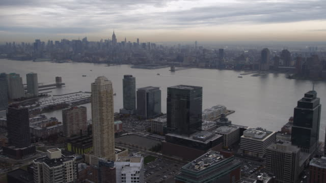 flying past skyscrapers of jersey city, looking across hudson to new york city. shot in 2011. - 50 seconds or greater stock videos & royalty-free footage