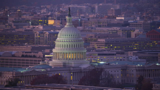 Flying past the Capitol at dusk, Library of Congress on right as clip ends. Shot in 2011.