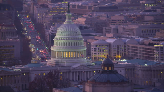 flying past the capitol at dusk with library of congress in front and pennsylvania avenue in background. shot in 2011. - senate stock videos & royalty-free footage