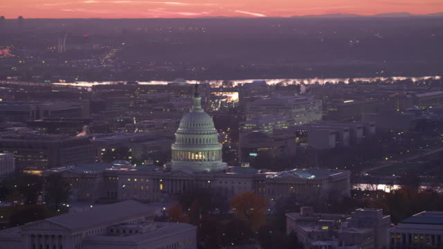 Flying past the Capitol Building at dusk with National Mall and Washington Monument in background. Shot in 2011.
