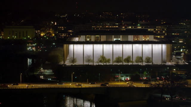 stockvideo's en b-roll-footage met flying past the kennedy center at night, washington dc. shot in 2011. - john f. kennedy