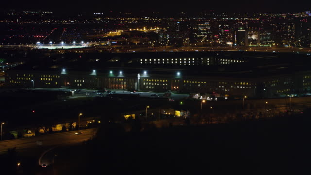 flying past the pentagon at night, washington dc in background. shot in 2011. - the pentagon stock videos and b-roll footage