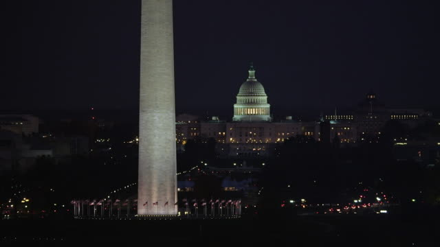 stockvideo's en b-roll-footage met flying past the washington monument at night, us capitol building in background. shot in 2011. - artbeats