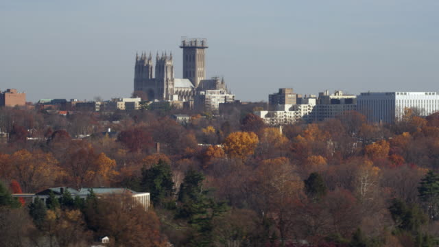 vídeos de stock, filmes e b-roll de flying past washington national cathedral in autumn. shot in november 2011. - artbeats
