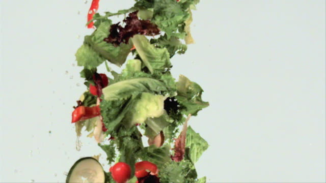 CU SLO MO Flying salad ingredients / San Francisco, California, USA