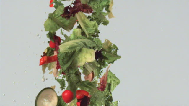 vídeos y material grabado en eventos de stock de cu slo mo flying salad ingredients / san francisco, california, usa - ensalada