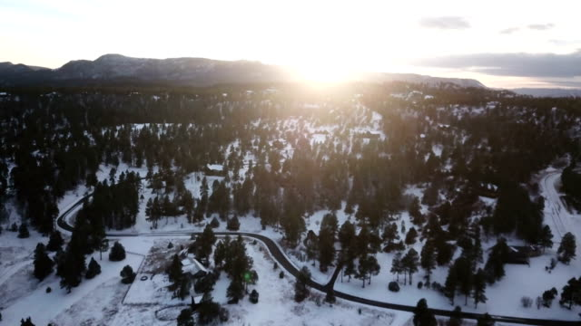 flying slowly toward sun setting on horizon in colorado - evergreen stock videos & royalty-free footage