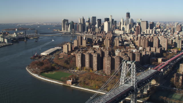Flying south above the East River from Williamsburg Bridge toward Financial District in Lower Manhattan. Shot in 2011.
