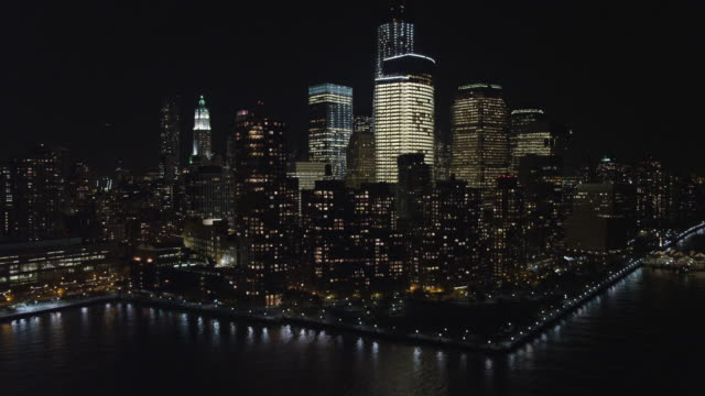flying south along the hudson river at night, gaining altitude on approach to lower manhattan financial district. shot in november 2011. - artbeats stock-videos und b-roll-filmmaterial