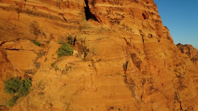 flying south and down the snow canyon ridge - sandstone stock videos & royalty-free footage