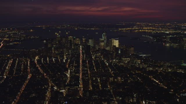 Flying south toward Financial District, wide view of Lower Manhattan and Upper New York Bay at night. Shot in November 2011.
