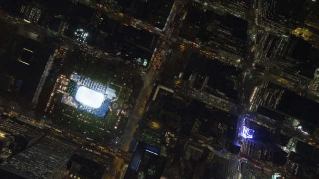 Flying southeast across Times Square and Rockefeller Center in Midtown Manhattan at night. Shot in 2011.