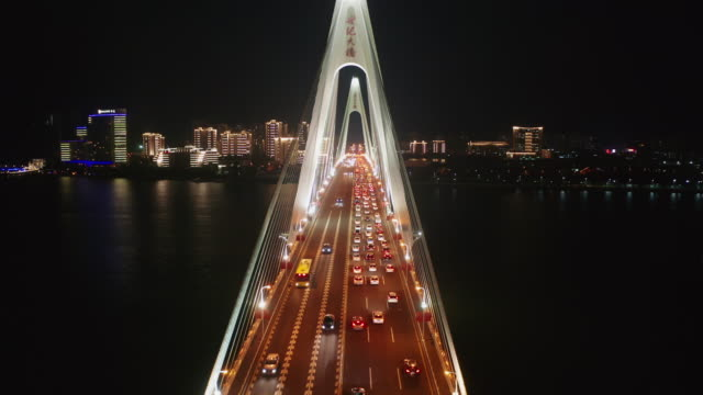flying through centry bridge while serious traffic jam, haikou city hainan province - suspension bridge stock videos & royalty-free footage