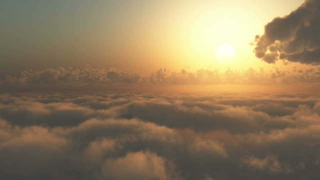 Flying through clouds at sunrise or sunset.