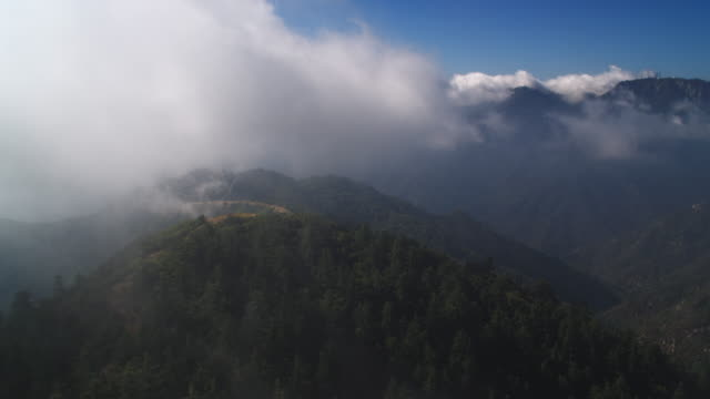 flying through clouds over the angeles national forest in the san gabriel mountains, california. shot in 2010. - angeles national forest stock videos and b-roll footage