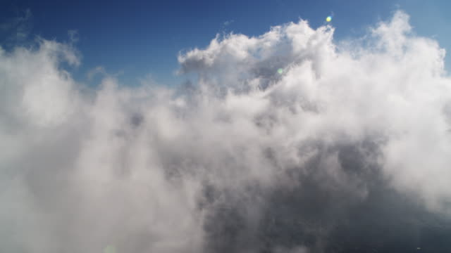 flying through clouds over the san gabriel mountains, california. shot in 2010. - angeles national forest stock videos and b-roll footage