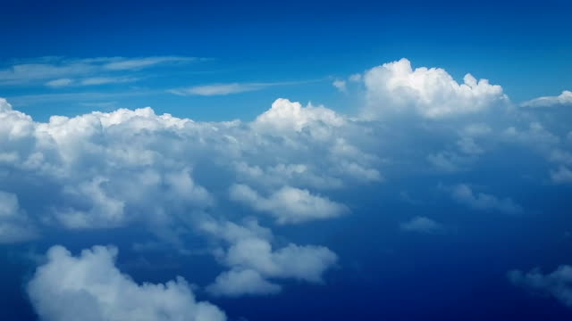vídeos de stock, filmes e b-roll de flying through clouds - sky only