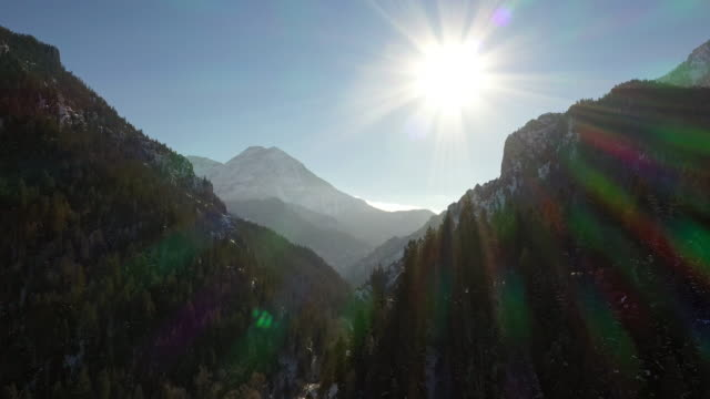 flying through deep canyon as the sun shines high above - american fork city stock videos & royalty-free footage