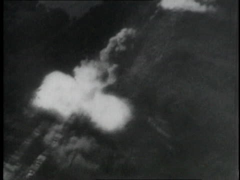 flying through flames / blowing up nazi emblem on building - luftwaffe stock-videos und b-roll-filmmaterial