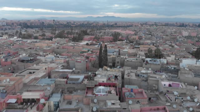 flying through foliage in a moroccan city - north africa stock videos & royalty-free footage