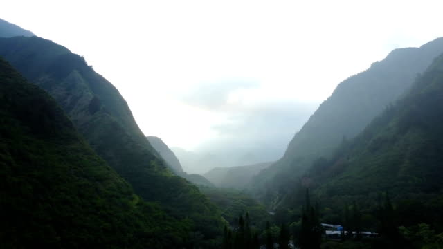 flying through long mountain valley on island of maui - maui stock videos & royalty-free footage