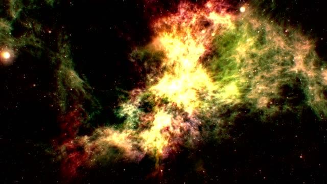 flying through multi colored nebula - supernova stock videos & royalty-free footage