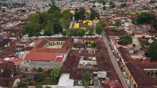 flying through santo domingo de guzman church - chiapas stock-videos und b-roll-filmmaterial