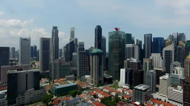 flying through singapore city with a drone - singapore stock videos & royalty-free footage