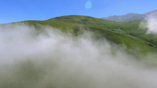 Flying through the clouds in the mountainous planes of Javaher Dasht, Iran.