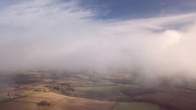 flying through the clouds over the cotswolds in gloucestershire - cotswolds stock videos & royalty-free footage