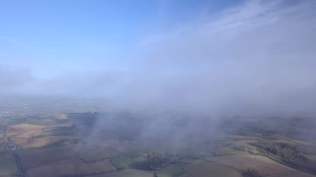 Flying through the clouds over the Cotswolds in Gloucestershire