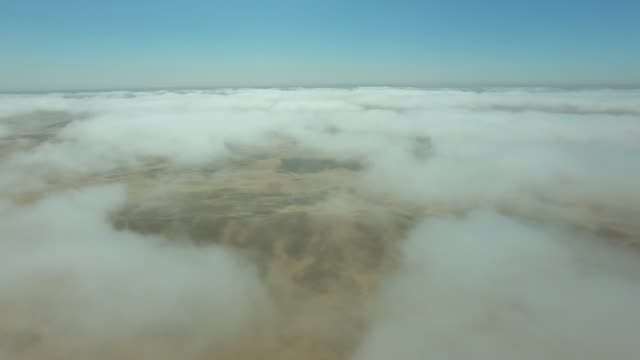 flying through the clouds over the namibian desert - namibian desert stock videos and b-roll footage