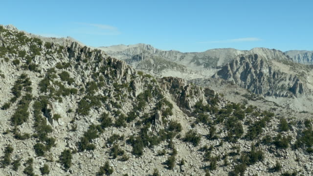 flying through the john muir wilderness area towards mount izaak walton, sierra nevada, california. - wilderness area stock videos & royalty-free footage
