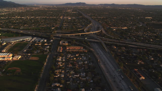 flying to orbit a complex highway interchange in los angeles - artbeats stock videos & royalty-free footage