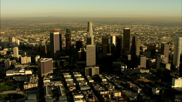 flying toward downtown la skyline of highrise buildings td flying over us bank tower other skyscrapers traffic on streets below ca - us bank tower stock videos & royalty-free footage