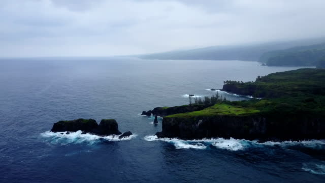 Flying Toward Huge Outcrop on Maui Island by Drone