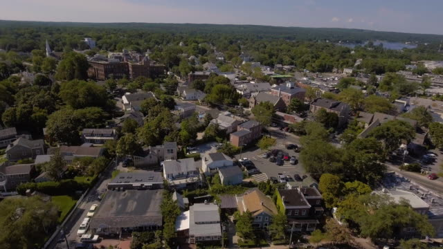 flying toward small long island town w/tilt down - long island video stock e b–roll