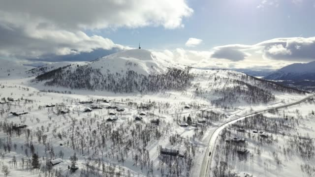 flying towards a snowy mountain top in vierli, norway. - eternity stock videos and b-roll footage