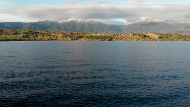 flying towards ranco lake shores in southern chile - aspetto naturale video stock e b–roll