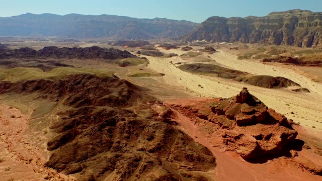 flying towards rocks over extreme terrain - canyon stock videos & royalty-free footage