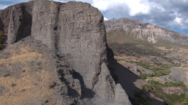 flying towards rocky cliff face - provo stock videos & royalty-free footage