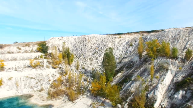 aerial: flying towards the limestone quarry - limestone stock videos and b-roll footage